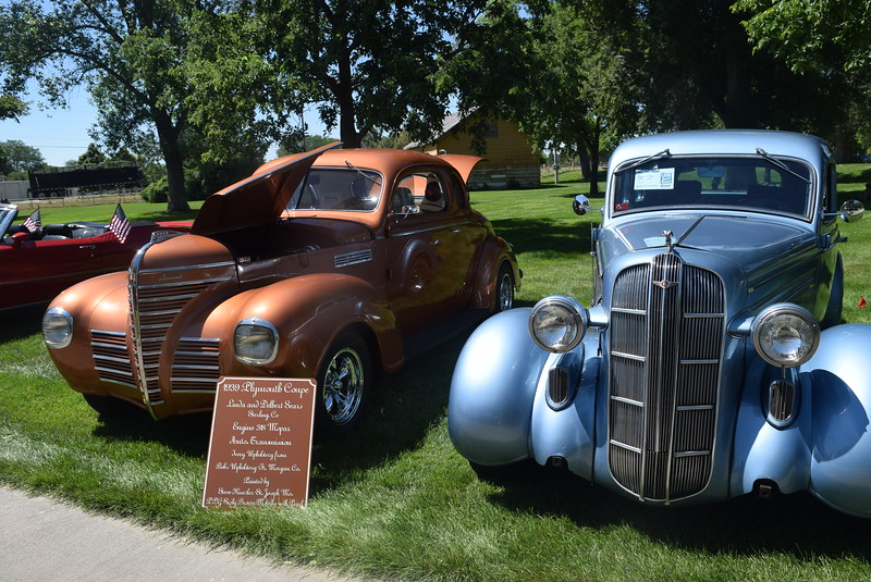 A 1939 Plymouth Coupe, left, and a 1936, Dodge, both owned by Linda and Delbert Sears, of Sterling, were among the cars on display at Colorado Flatlanders 25th Annual Rod Run in the Park Saturday, July 9, 2016, at Pioneer Park.