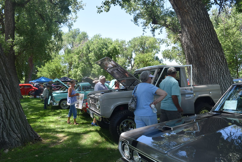 Visitors look over vehicles on display at Colorado Flatlanders 25th Annual Rod Run in the Park Saturday, July 9, 2016, at Pioneer Park.