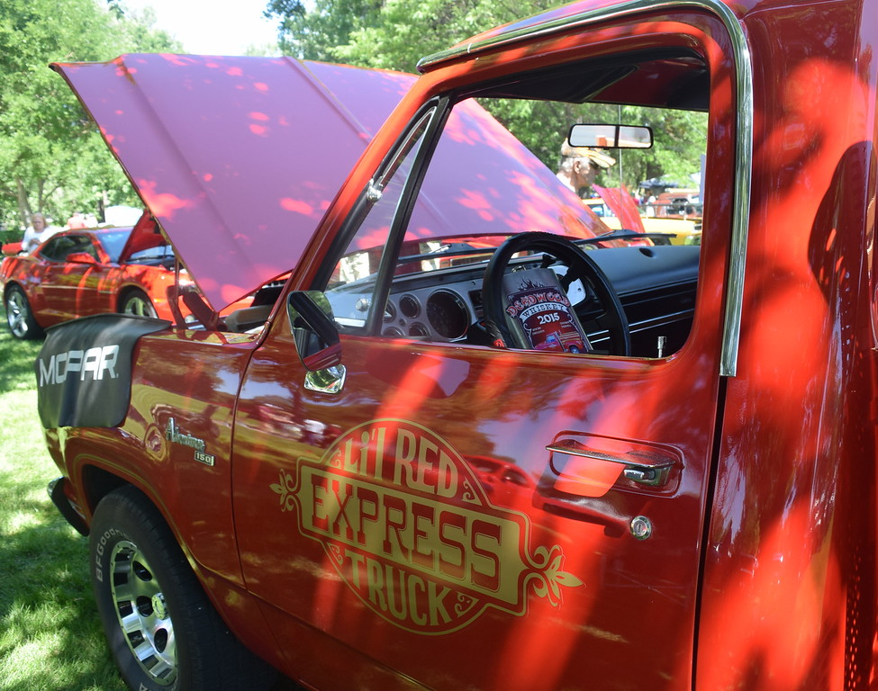 A bottle of Deadwood Whiskey sits on the steering wheel of a 1979 Dodge Lil Red Express Truck, owned by John Phillips, of Sidney, Neb., one of several vehicles on display at Colorado Flatlanders 25th Annual Rod Run in the Park Saturday, July 9, 2016, at Pioneer Park.
