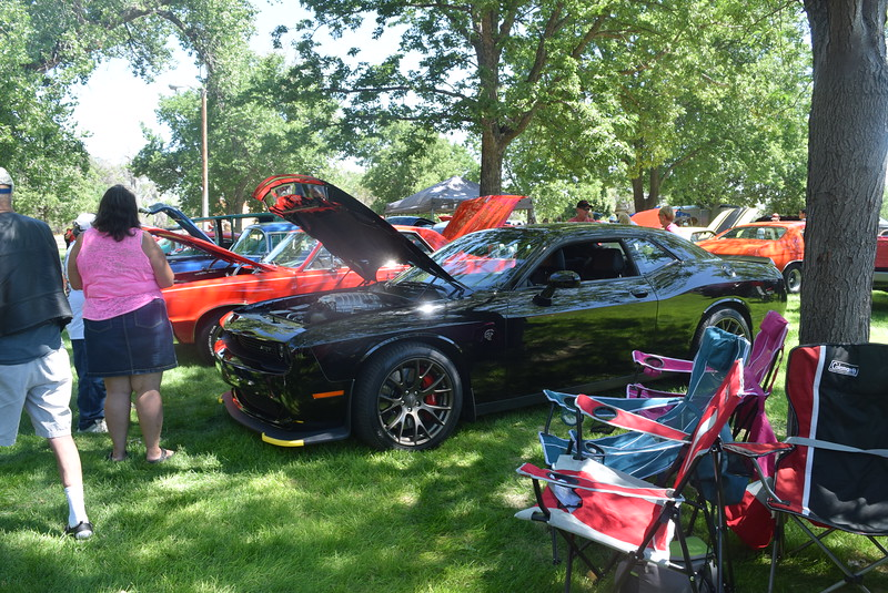 Guests look over some of the vehicles at Colorado Flatlanders 25th Annual Rod Run in the Park Saturday, July 9, 2016, at Pioneer Park.