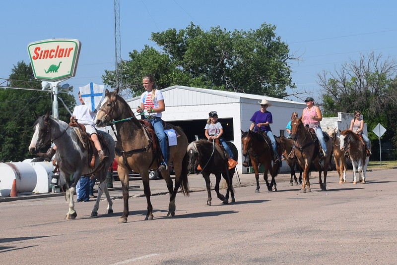 Crook Rodeo Bible Camp members make their way down the parade route at the Crook Fair Saturday, July 29, 2016. White Knight of Chess, Chance Mitchell, front left, carrying a sword and shield was the first place winner in the Horse category.