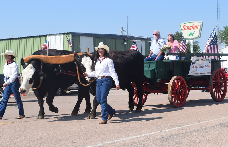 The Brompton Family's wagon carries Crook Fair Royalty Dave and Colleen Seifried along the parade route Saturday, July 29, 2016.