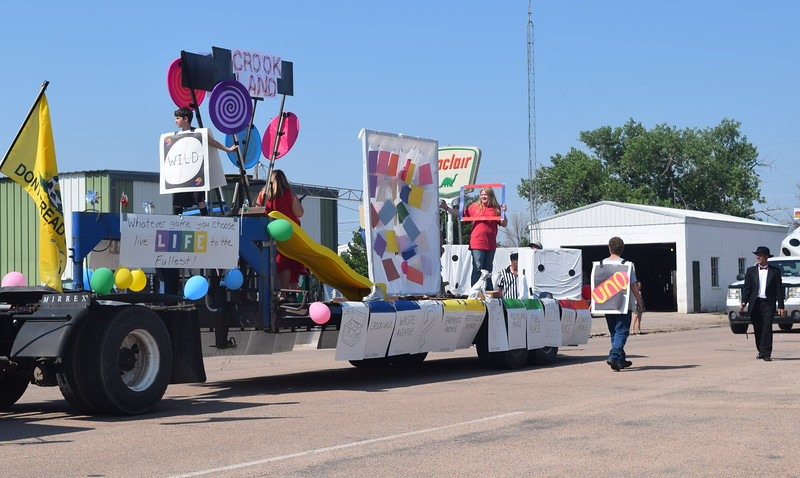 "Marick's Waste Disposal's float in the Crook Fair Parade, Saturday, July 29, 2016, encouraged people to ""live life to the fullest."" It took first place in the business category."