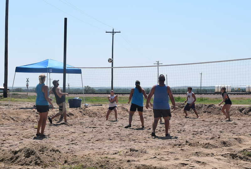 Competitors keep a close on the ball during a game in the LeBlanc/Stieb Memorial Volleyball Tournament at the Crook Fair Saturday, July 29, 2016.