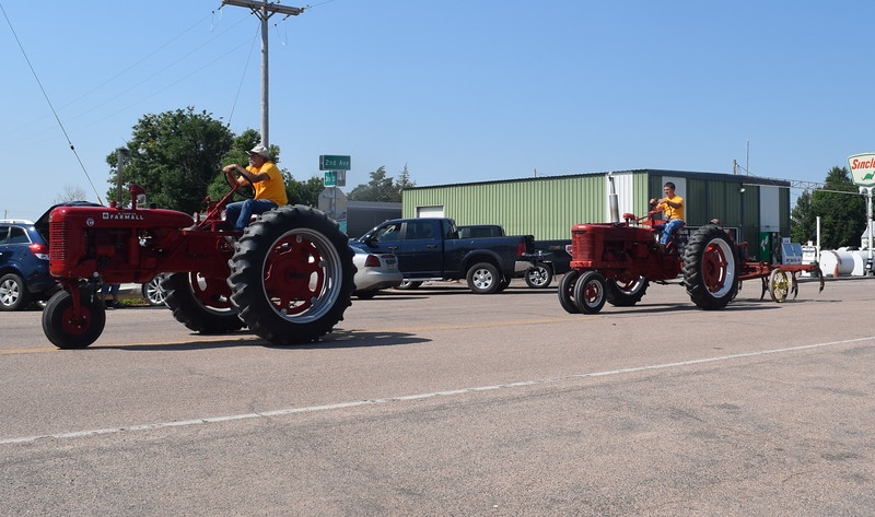 Tractors make their way through downtown Crook during the Crook Fair Parade Saturday, July 29, 2016.
