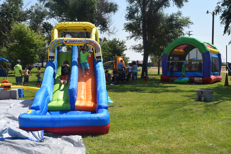 Water slides and bouncy houses provided fun for children  at the Crook Fair Saturday, July 29, 2016.