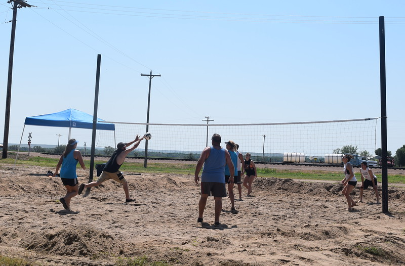 A competitor reaches for the ball during one of the games in the LeBlanc/Stieb Memorial Volleyball Tournament at the Crook Fair Saturday, July 29, 2016.