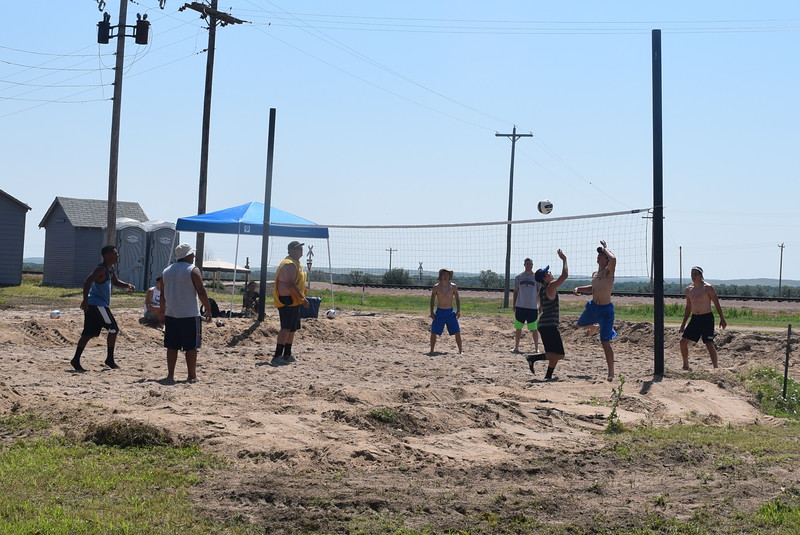 Two competitors try to reach the ball during one of the games in the LeBlanc/Stieb Memorial Volleyball Tournament at the Crook Fair Saturday, July 29, 2016.