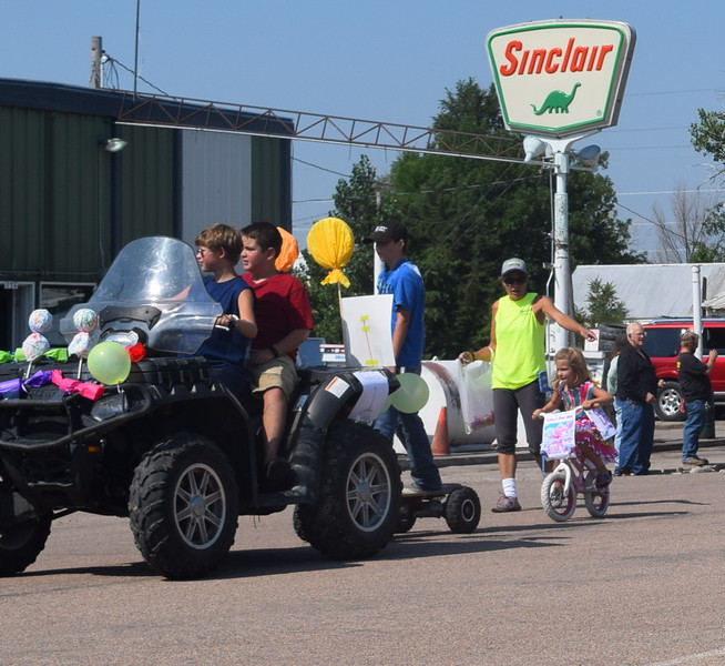 "A ""Crook Land"" themed float makes its way through downtown Crook during the Crook Fair Parade Saturday, July 29, 2016. Behind it is Lollipop Girl, Adyson Harms, who took first place in the Under 12 category."