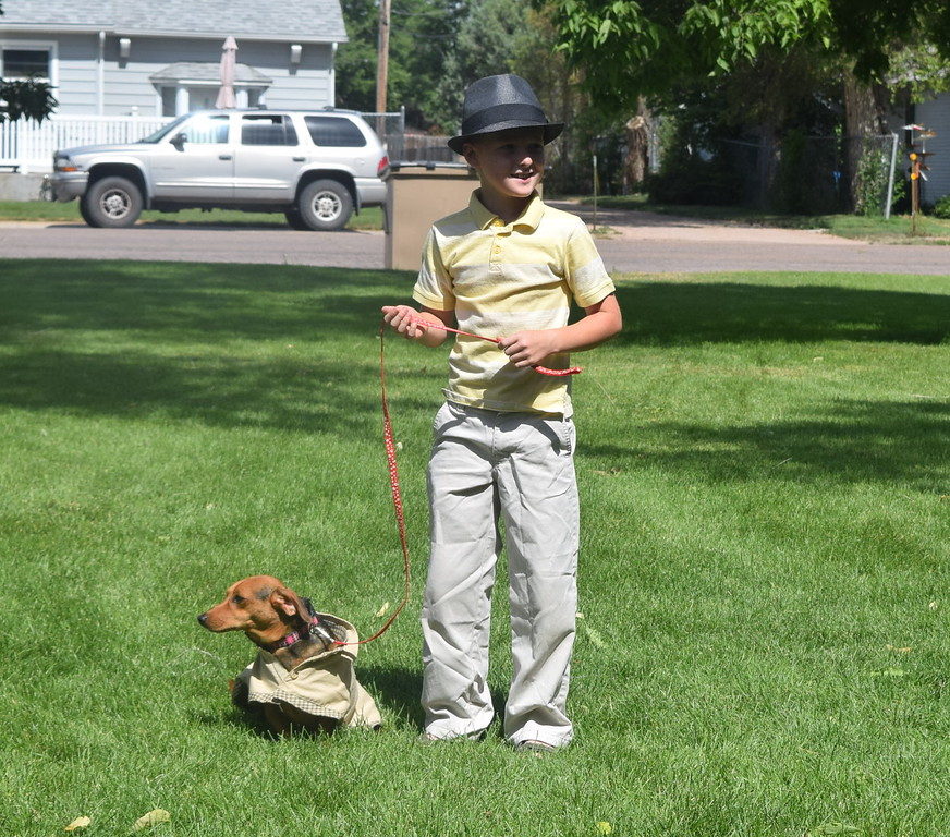 Logan Leonard and his dachshund Bandit dressed as Sherlock Holmes and his assistant for the Pet/Owner Look-alike division of the Kids Pet Show Saturday, July 16, 2016. They placed third in the division.
