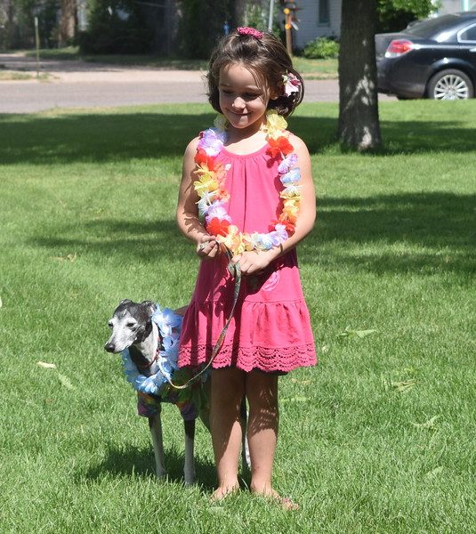 Ava Cromwell and her Italian greyhound Ozzie wore their best Hawaiian looks for the Pet/Owner Look-alike division of the Kids Pet Show Saturday, July 16, 2016. They took second place in the division.