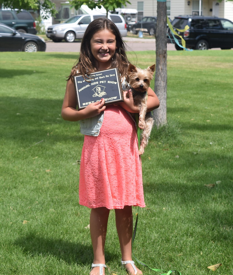 Kiley Long and her dog Duncan, a Yorkshire, won the Best in Show at the 2016 Kids Pet Show Saturday, July 16, 2016.