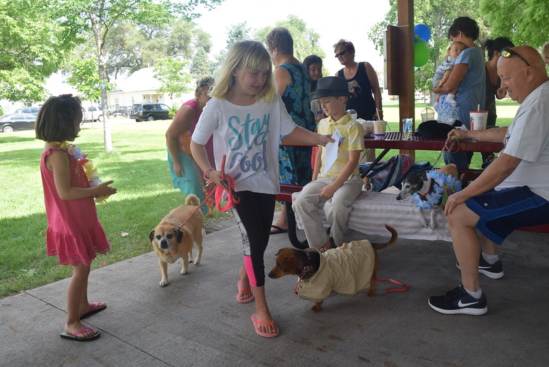 Carlee Hicks accepts the Least Motivated award on behalf of her brother Alex and his puggle Trixie at the Kids Pet Show Saturday, July 16, 2016.