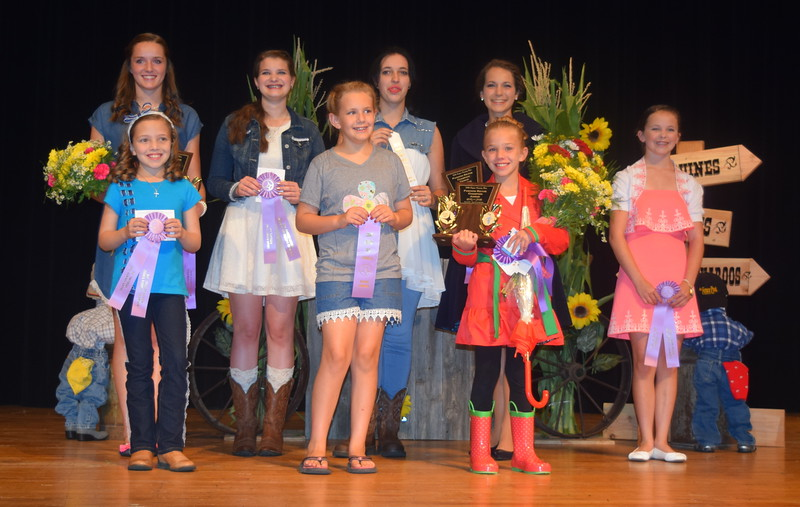 "Pictured are the winners of the ""Equines, Bovines and Little Buckaroos!"" Logan County Fair 4-H Fashion Revue Friday, July 29, 2016. Front row, from left; Ayla Baney, reserve champion junior division; Ashton Nichols, reserve champion encore division; Hallie Lewis, champion junior division; Aly Young, reserve champion senior division; back row, from left; Lauren Fritzler, champion intermediate division; Kathryn Lock, reserve champion intermediate division; Shelby Houser, third place winner senior division; and Rachael Northup, champion encore and senior divisions."