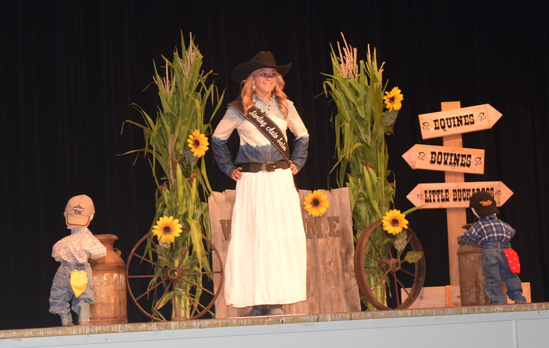 "Queen Contestant McKaylin Schreiner models her outfit at the ""Equines, Bovines and Little Buckaroos!"" Logan County Fair 4-H Fashion Revue Friday, July 29, 2016."