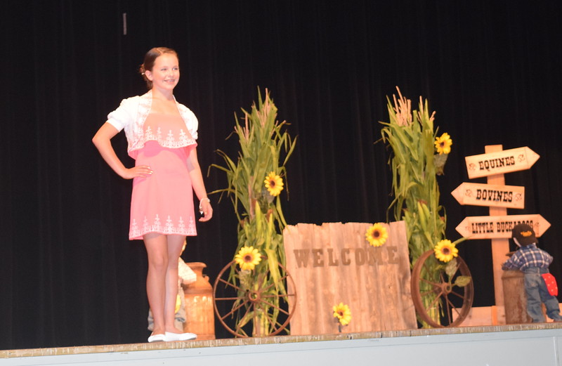 "Aly Young models her outfit in the senior division of the ""Equines, Bovines and Little Buckaroos!"" Logan County Fair 4-H Fashion Revue Friday, July 29, 2016."