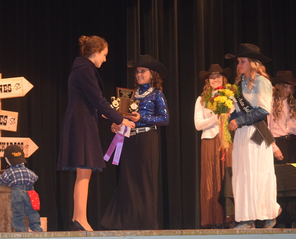 "Logan County Sweetheart Abbey Zink and Queen Contestant McKaylin Schreiner present awards to Rachael Northup champion in the senior division of the ""Equines, Bovines and Little Buckaroos!"" Logan County Fair 4-H Fashion Revue Friday, July 29, 2016."