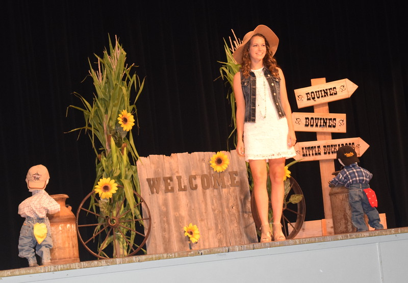 "Rachael Northup models her outfit in the encore division of the ""Equines, Bovines and Little Buckaroos!"" Logan County Fair 4-H Fashion Revue Friday, July 29, 2016."