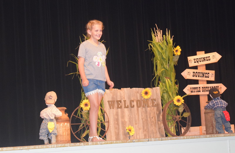 "Ashton Nichols models her outfit in the junior division of the ""Equines, Bovines and Little Buckaroos!"" Logan County Fair 4-H Fashion Revue Friday, July 29, 2016."