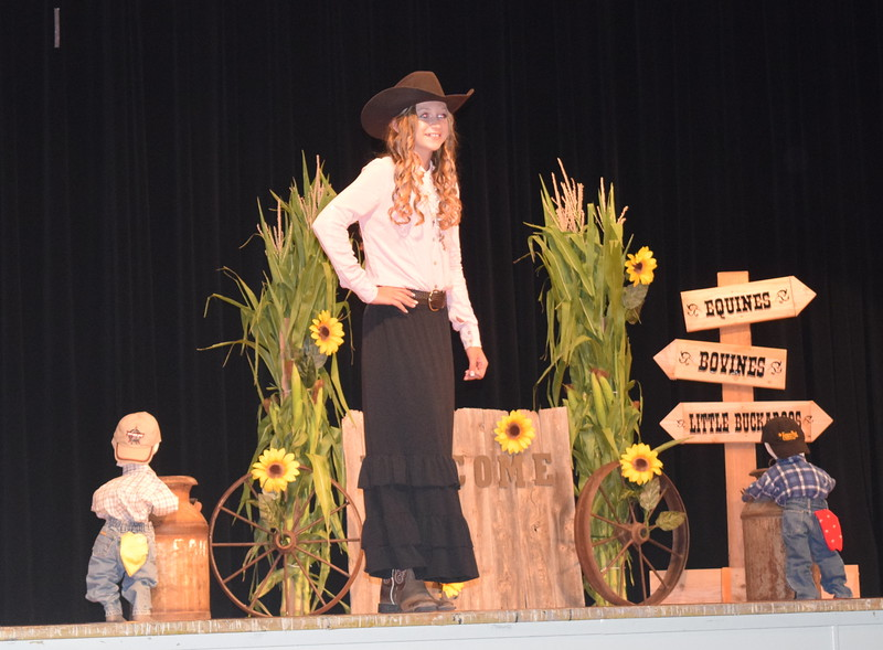 "Logan County Sweetheart Bobbie Schreiner models her outfit at the ""Equines, Bovines and Little Buckaroos!"" Logan County Fair 4-H Fashion Revue Friday, July 29, 2016."