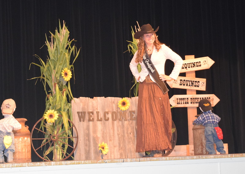 "Queen Contestant Jessica Sigmon models her outfit at the ""Equines, Bovines and Little Buckaroos!"" Logan County Fair 4-H Fashion Revue Friday, July 29, 2016."