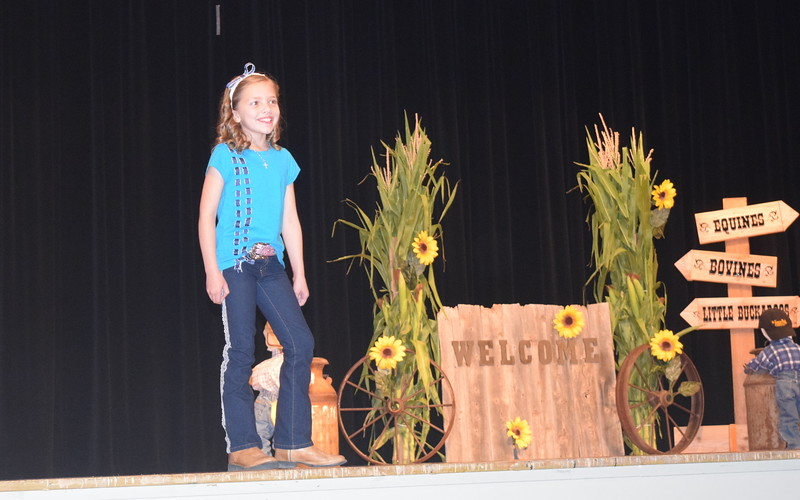 "Ayla Baney models her outfit in the junior division of the ""Equines, Bovines and Little Buckaroos!"" Logan County Fair 4-H Fashion Revue Friday, July 29, 2016."