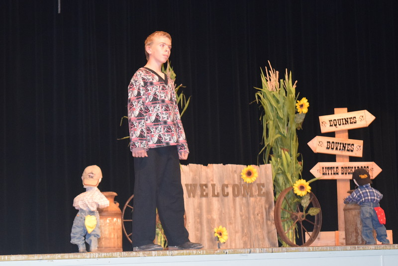 "Charles Fehringer models his outfit in the intermediate division of the ""Equines, Bovines and Little Buckaroos!"" Logan County Fair 4-H Fashion Revue Friday, July 29, 2016."