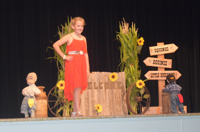 "Ashton Nichols models her outfit in the encore division of the ""Equines, Bovines and Little Buckaroos!"" Logan County Fair 4-H Fashion Revue Friday, July 29, 2016."