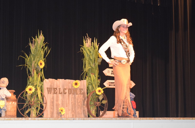 "Miss Rodeo Logan County 2016 Abbey Brower models her outfit at the ""Equines, Bovines and Little Buckaroos!"" Logan County Fair 4-H Fashion Revue Friday, July 29, 2016."