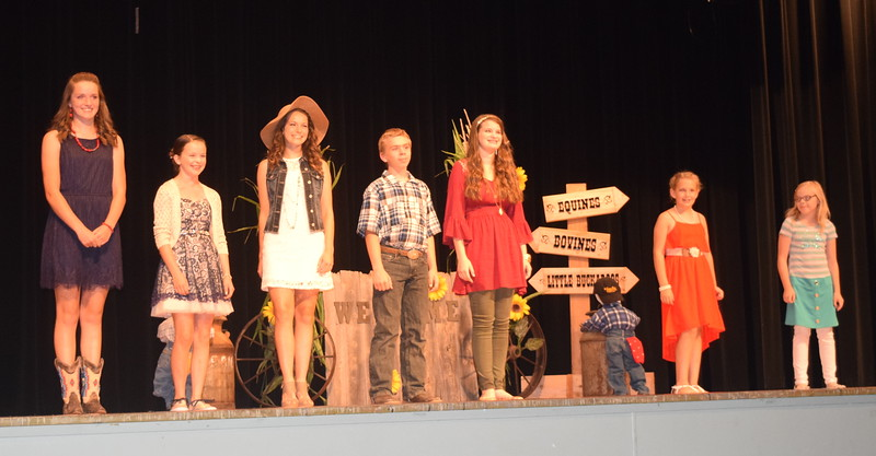 "Competitors model their outfits in the encore division of the ""Equines, Bovines and Little Buckaroos!"" Logan County Fair 4-H Fashion Revue Friday, July 29, 2016. From left; Lauren Fritzler, Aly Young, Rachael Northup, Charles Fehringer, Kathryn Lock, Ashton Nichols and Sadie Fehringer."