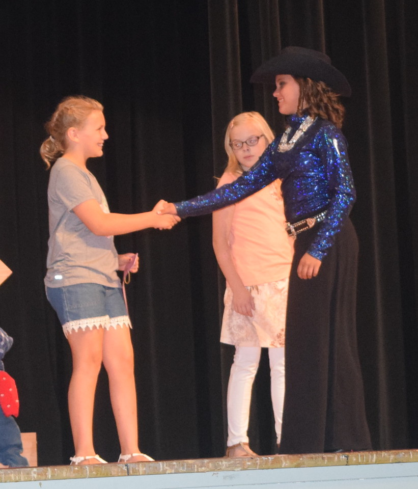 "Logan County Sweetheart Abbey Zink, right, congratulates Ashton Nichols, reserve champion in the encore division of the ""Equines, Bovines and Little Buckaroos!"" Logan County Fair 4-H Fashion Revue Friday, July 29, 2016."