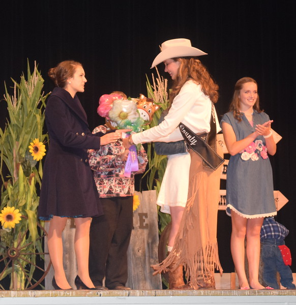 "Miss Rodeo Logan County 2016 Abbey Brower congratulates Rachael Northup champion in the encore division of the ""Equines, Bovines and Little Buckaroos!"" Logan County Fair 4-H Fashion Revue Friday, July 29, 2016."