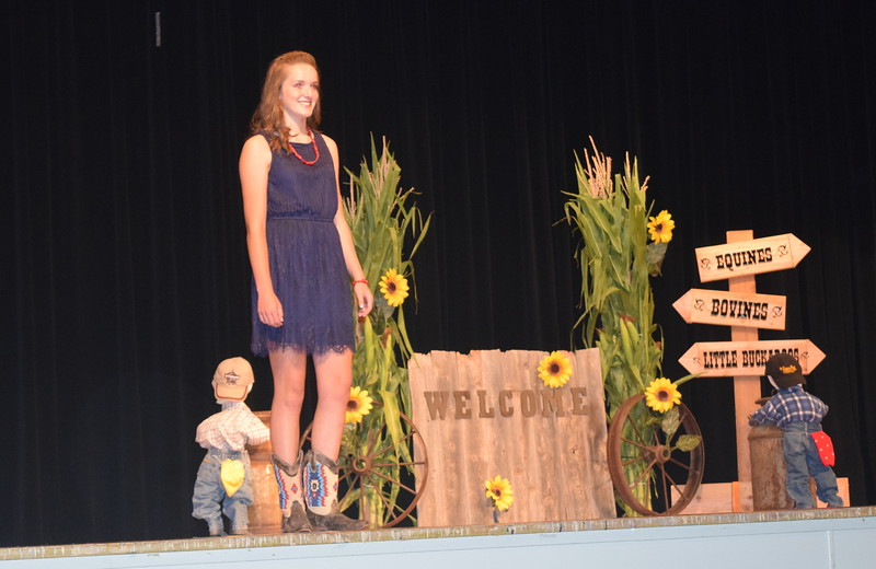 "Lauryn Fritzler models her outfit in the encore division of the ""Equines, Bovines and Little Buckaroos!"" Logan County Fair 4-H Fashion Revue Friday, July 29, 2016."