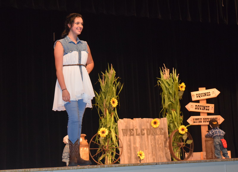 "Shelby Houser models her outfit in the senior division of the ""Equines, Bovines and Little Buckaroos!"" Logan County Fair 4-H Fashion Revue Friday, July 29, 2016."