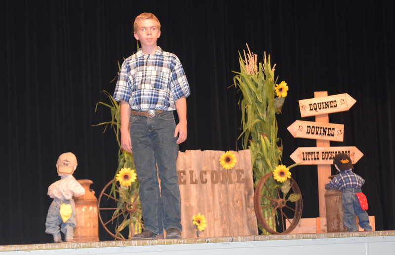 "Charles Fehringer models his outfit in the encore division of the ""Equines, Bovines and Little Buckaroos!"" Logan County Fair 4-H Fashion Revue Friday, July 29, 2016."