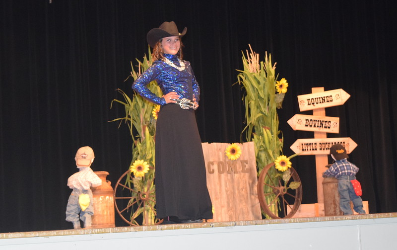 "Logan County Sweetheart Abbey Zink models her outfit at the ""Equines, Bovines and Little Buckaroos!"" Logan County Fair 4-H Fashion Revue Friday, July 29, 2016."