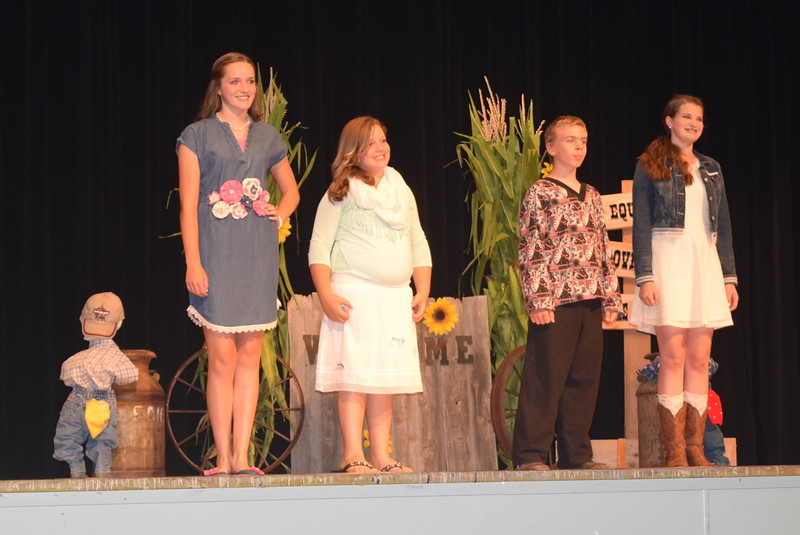 "Competitors in the intermediate division model their outfits at the ""Equines, Bovines and Little Buckaroos!"" Logan County Fair 4-H Fashion Revue Friday, July 29, 2016. From left; Lauren Fritzler, Hollie Walther, Charles Fehringer and Kathryn Lock."