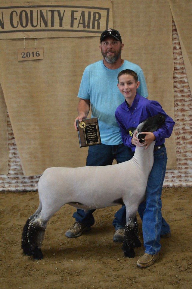 Cooper DeWitt and father Brad, Champion Intermediate Sheep Showman