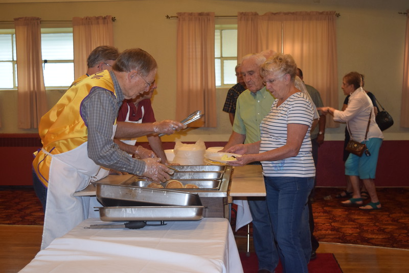 Guests line up for pancakes, eggs and sausage Wednesday, Aug. 3, 2016, at the Sterling Lions Club's annual Cowboy Breakfast, a Logan County Fair tradition.