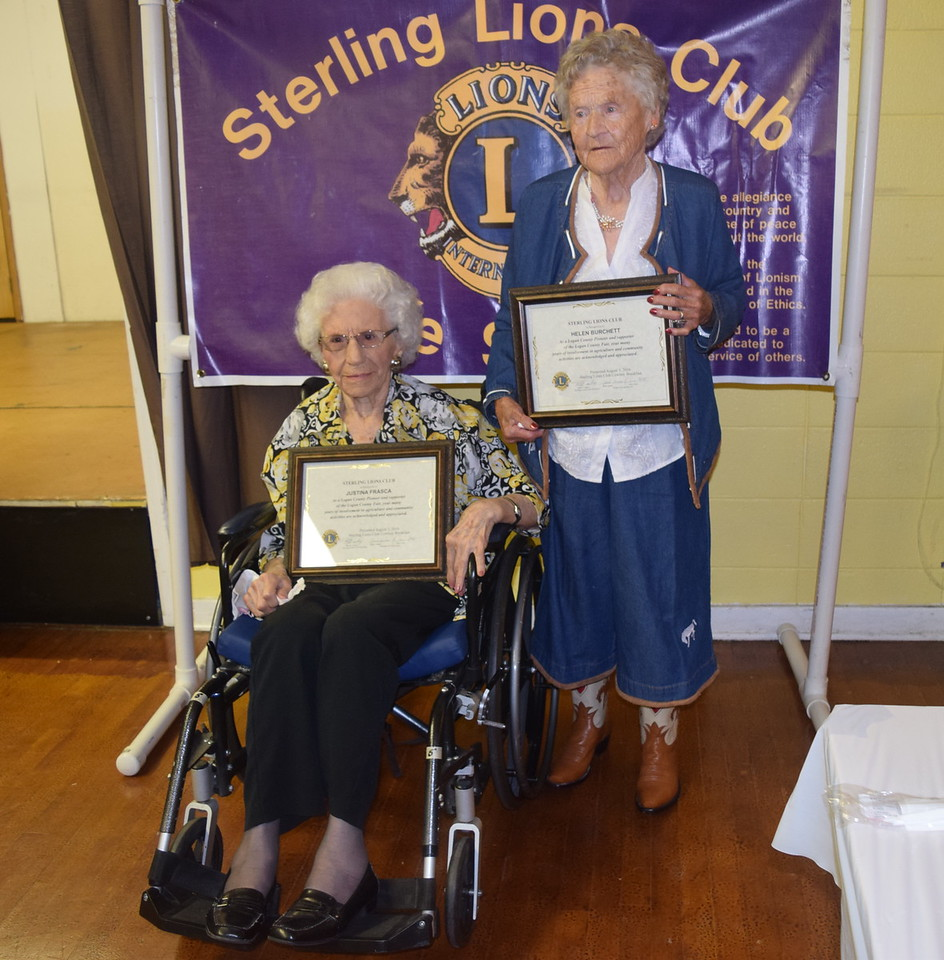 This year's recipients of Sterling Lions Club's Pioneer Awards were Justina Frasca, left, and Helen Burchett, who is wearing the special Olsen-Stelzer cowboy boots she received for her 102nd birthday last year.