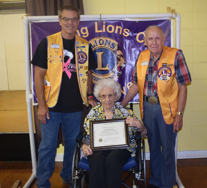 Sterling Lions Club members Dave Fast, left, and Jack Annan, present the club's Pioneer Award to Justina Frasca Wednesday, Aug. 3, 2016, at the Cowboy Breakfast.