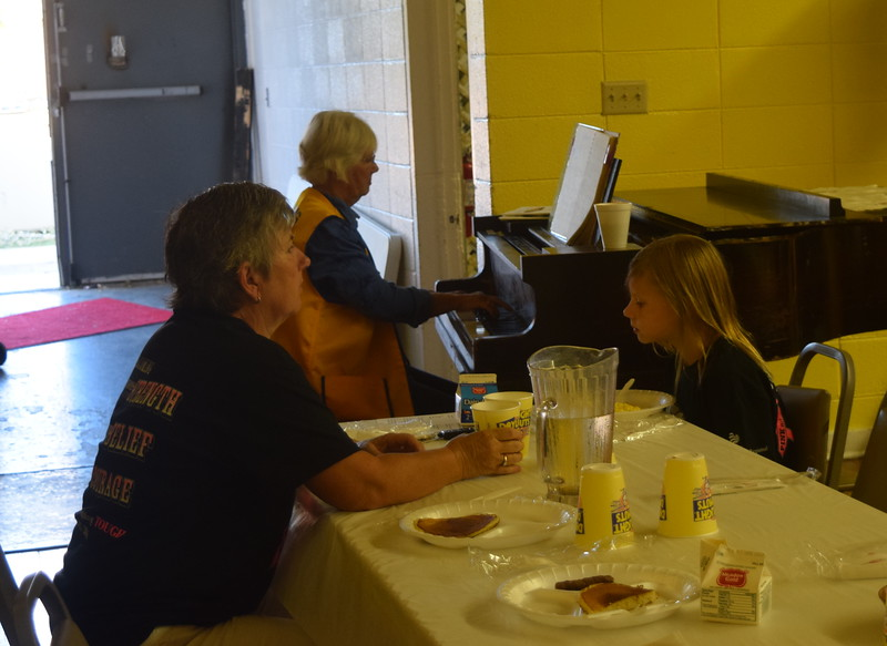 Lion Audrey Carey provided musical entertainment for guests during Sterling Lions Club's Cowboy Breakfast Wednesday, Aug. 3, 2016.
