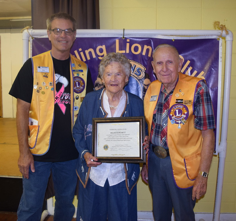 Sterling Lions Club members Dave Fast, left, and Jack Annan present the club's Pioneer Award to Helen Bruchett Wednesday, Aug. 3, 2016, at the Cowboy Breakfast.