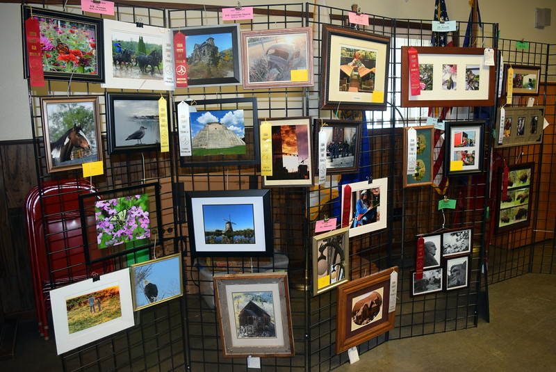 Photographs hang on display in the Gary DeSoto Building Thursday, Aug. 4, 2016, at the Logan County Fair.