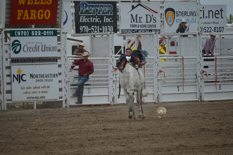 Eric Gewecke of Gillette, Wyo., marks his mount out of the chute Thursday night enroute to a 75.5 score and first place in saddle bronc riding event of ther Dick Stull Memorial PRCA Rodeo.