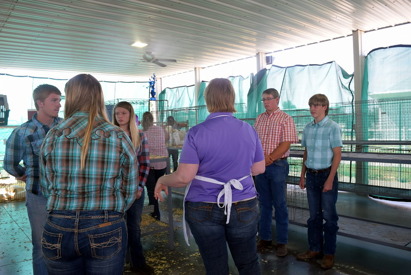 Judge Colleen Gattshall talks with competitors in the Junior Poultry Show Thursday, Aug. 4, 2016, at the Logan County Fair.