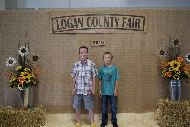 Degan Buchetl, right, champion junior rabbit showman and reserve champion breeding rabbit, and Braylon Bruns, grand and reserve champion single meat chickens, grand champion breeding poultry, grand champion photography overall and reserve champion foods overall.