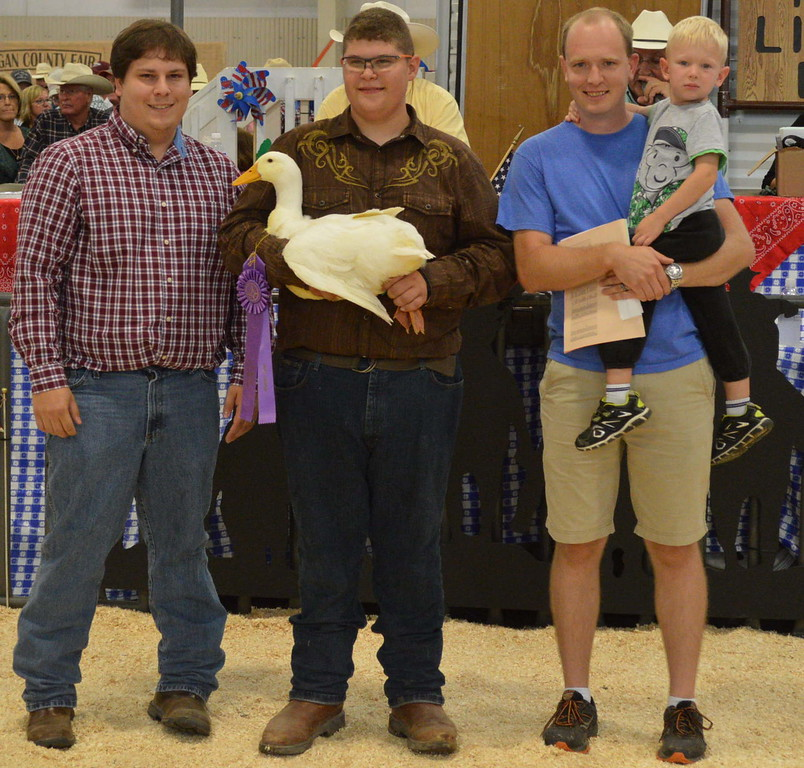 Grand Champion Market Poultry, shown by Thomas Rutherford, $800 paid by New Method Cleaners, Nelson Financial, and South Platte Insurance.