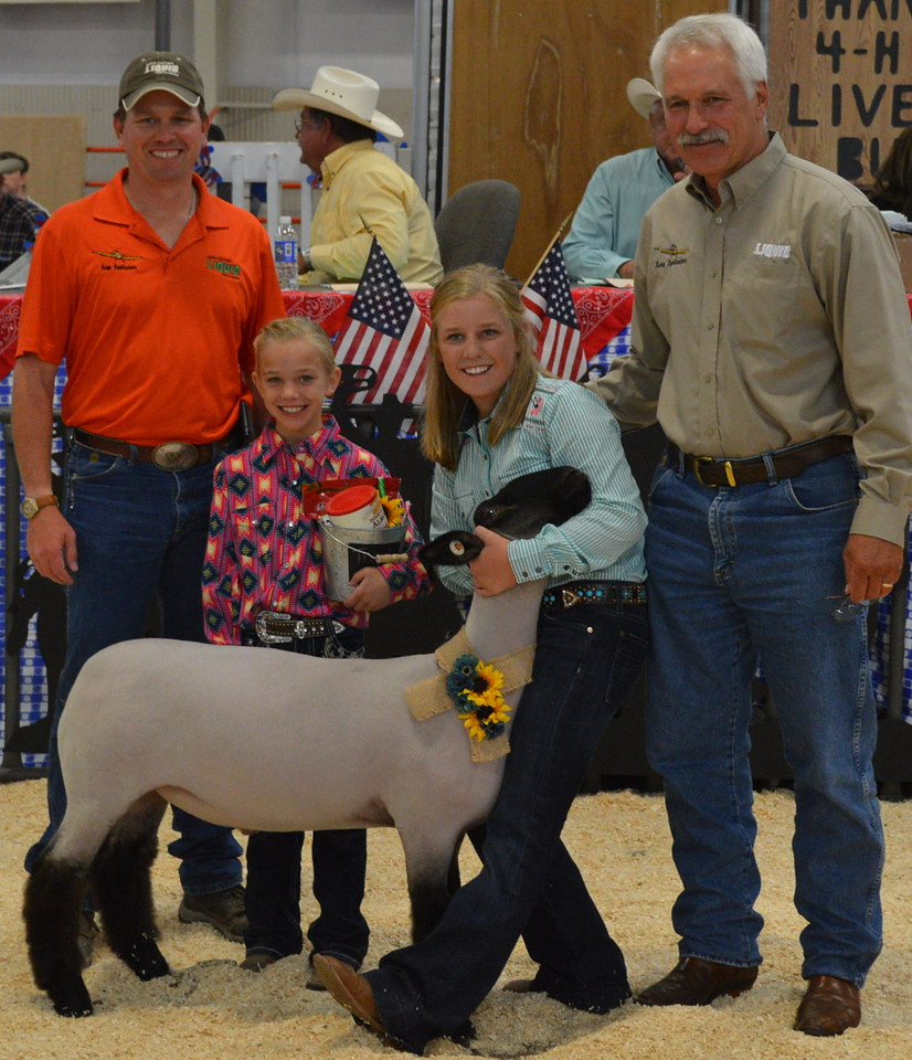 Reserve Grand Champion Market Sheep, shown by Kinlie Lewis, $2,750 paid by AeroApplicators