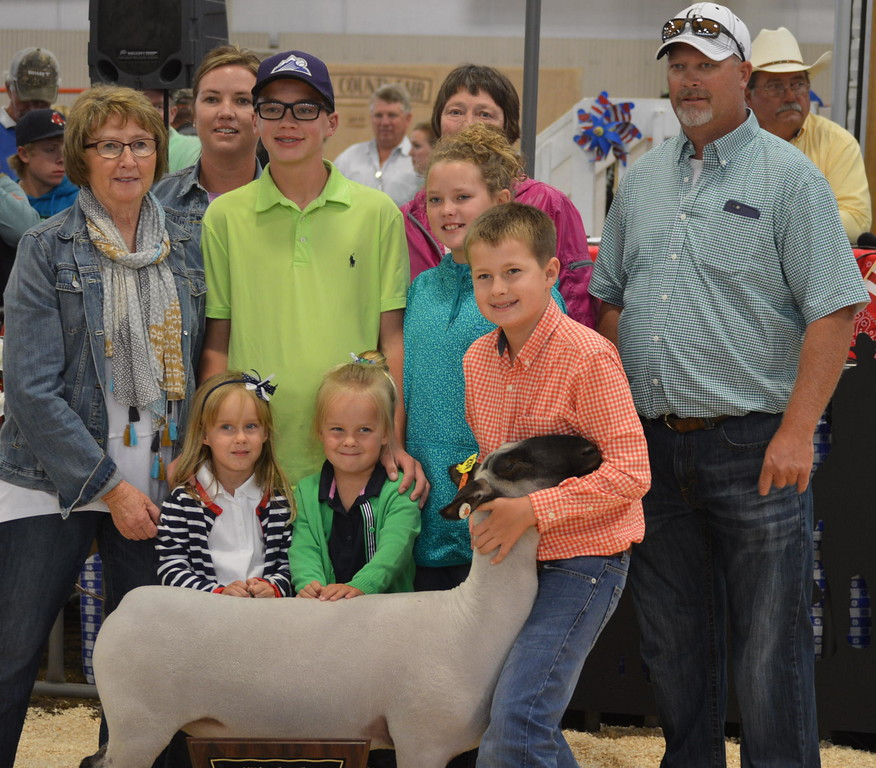 Grand Champion Market Sheep, shown by Jaxson Samber, $5,000 paid by Dewey's Bar & Grill, Jeannie Miller, Carl & Diane Miller, Cory and Shanan Kessinger, Zoetis, and Frontier Bank of Pueblo